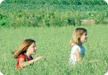 Kids running through field