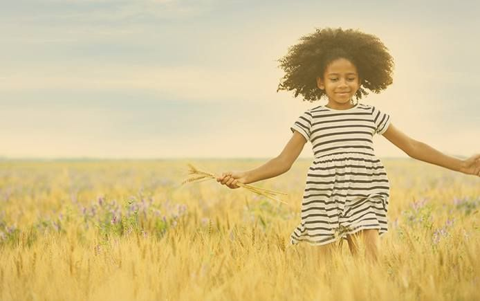 Girl running field