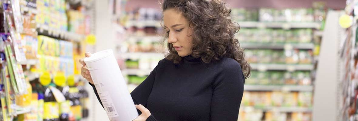 Woman shopping looks at label