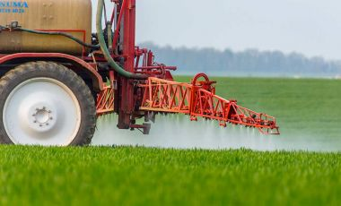 Spraying pesticide gmo