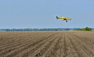 Crop duster spray pesticides