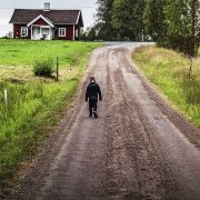 kid walking rural lane