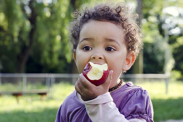 CHild eat apple